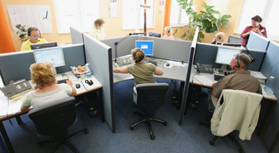 WITTENBERGE, GERMANY - JUNE 14: Telephone operators work at a call centre of the employment agency Adecco on June 14, 2007 in Wittenberge, Germany. Call centres, a growing industry in eastern Germany, offer companies a 24 hour call centre solution service.  (Photo by Andreas Rentz/Getty Images)